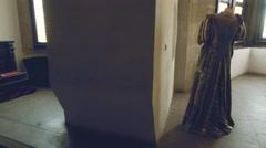View of gorgeous renaissance historical dresses inside a castle Stock Footage