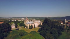 Panorama of green fields with a medieval castle and small town in the background Stock Footage
