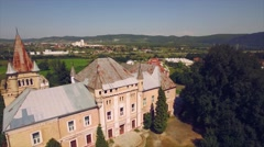 Panorama of green fields with a medieval castle and small town Stock Footage
