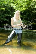 Woman fishing in river Stock Photos