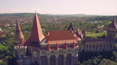 Vertical aerial view of beautiful medieval castle with beautiful green fields Stock Footage