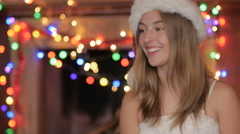 A jolly happy attractive blond woman laughing in the holiday spirit Stock Footage