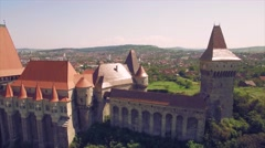 Aerial view of beautiful medieval castle with beautiful green hills Stock Footage