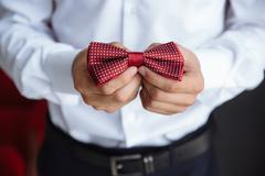 Man holding bow tie. Elegant gentleman clother Stock Photos