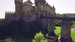 Close aerial view of a medieval castle with bridge Stock Footage