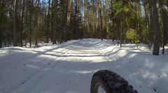 Cyclist riding bicycle, extreme winter cycling in forest on cross country bike Stock Footage