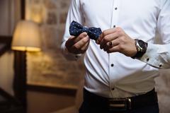 Man holding bow tie. Elegant gentleman clother Stock Photos