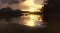 Water patterns reflecting sunrise, Glacier National Park, MT Stock Footage