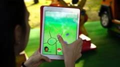 Samara, Russia - woman playing pokemon go on his ipad Stock Footage