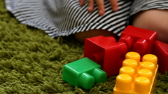 Cute little girl playing with toy blocks, closeup Stock Footage