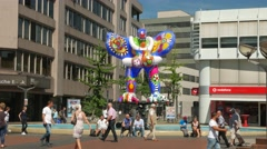 4K Downtown shopping street Livesaver fountain sculpture in Duisburg NRW Germany Stock Footage