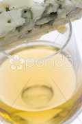 Glass of Tokai wine with roquefort chees Stock Photos