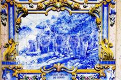 Tiles (azulejos) at railway station of Pinhao, Douro Valley, Portugal Stock Photos