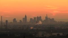 Frankfurt Skyline against red sky at dawn Stock Footage