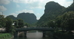 Man crossing the bridge in Trang An, Vietnam Stock Footage
