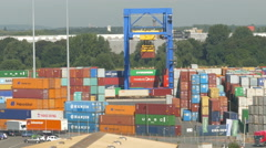 4K Crane moving container in harbour Rhine river in Duisburg NRW Germany Europe Stock Footage