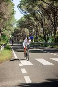 Grosseto, Italy - May 09, 2014: The disabled cyclist with the bike Stock Photos