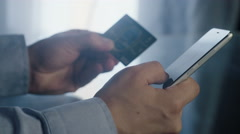 Man makes a purchase over the Internet by credit card Stock Footage