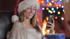 Happy woman completes her online order and says yes during Christmas Stock Footage