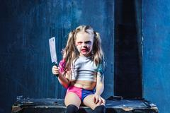 Horror shot: a scary evil girl with bloody knife Kuvituskuvat