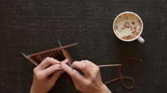 Knitting and coffee on black background Stock Footage