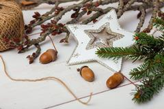 Christmas Background- Christmas toy, acorns, tree branch. Stock Photos