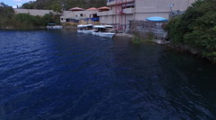 Facing the Hotel while over the Volcanic Lake Cuicocha in the Andes Stock Footage