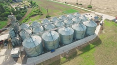 Steel grain silos elevators storage 4k aerial video. Agriculture industry Stock Footage