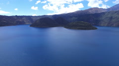 Facing the Islands in Volcanic Lake Cuicocha Stock Footage