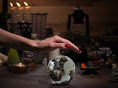 Hands witch. Transparent sphere. Magical objects and utensils of the alchemis Stock Photos