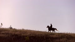 Horse rider moving in slo-mo. Stock Footage