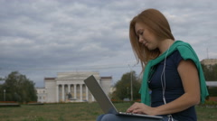 Student talking on the Internet on a laptop Stock Footage