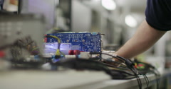 Male worker in an electronics factory working on computer testing and repairs Stock Footage