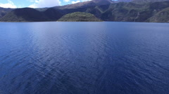 Over the Blue Waters of Facing the Volcanic Lake Cuicocha in the Andes Stock Footage