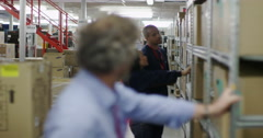 Portrait of business manager in a warehouse or factory Stock Footage