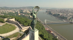 Aerial view of Budapest in Citadell - Liberty statue at sunrise, Hungary Stock Footage