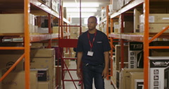 Timelapse of busy workers in a warehouse or factory Stock Footage