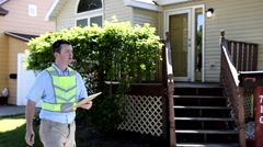 Utility maintenance repair man searching house meter w Notepad 2 Stock Footage