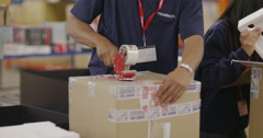 Workers in a warehouse or factory checking stock and preparing deliveries Stock Footage