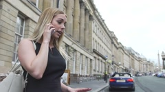 Sexy good looking young blonde woman angry mobile phone cell call london street Stock Footage