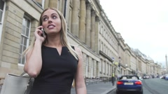 Sexy good looking  blonde woman black dress happy cell mobile phone call london Stock Footage