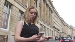 Sexy Attractive good looking young blonde woman in paying online london street Stock Footage