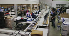 Timelapse of busy team of workers building computers in electronics factory Stock Footage