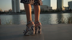 Girl walking on high heels in the evening Stock Footage