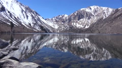 An alpine mountain lake reflects sierra nevada snow in winter. Stock Footage