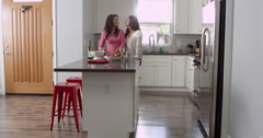 Lesbian couple preparing meal together at home, full length, shot on R3D Stock Footage