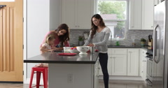 Girl and her female parents preparing meal, full length, shot on R3D Stock Footage