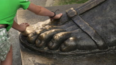 Touching large Bronze Foot of statue Of Gregory Of Nin  Split Croatia Stock Footage