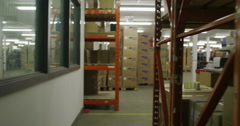Lots of rows of shelves in electronics factory warehouse Stock Footage