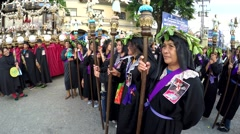 Women penitents in lenten garb Stock Footage